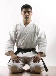 Black Belt in Karate Kneeling
