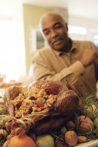 Man Looking at Cooked Turkey, Blurred.