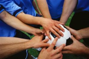 Multiple Players Holding Soccer Ball